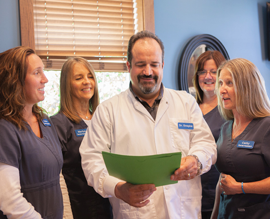 Northern Family Dental Team Looking at patient file